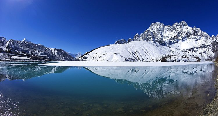 Holy lake of Dudh Pokhari with Pharilapche behind, Gokyo, Solukhumbu District, Sagarmatha National Park, UNESCO World Heritage Site, Nepal, Himalayas, Asia