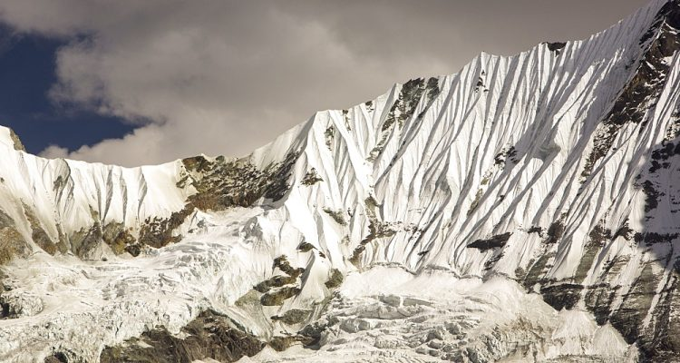 A rapidly retreating glacier on the side of the 6428 metre peak of Gandharwa Chuli in the Annapurna Sanctuary, Nepalese Himalayas, Nepal, Asia