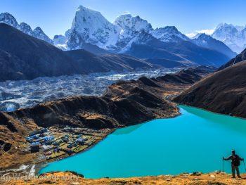 尼泊尔-喜马拉雅山区-Gokyo Ri-壮丽山河  Male trakker standing on Gokyo Ri (5,357 m), enjoying the breathtaking view of the Himalaya mountains (Cholatse and Taboche to the left), Ngozumpa glacier, and Gokyo lakes (the world's highest freshwater lakes), near the village of Gokyo, in Sagarmatha National Park, UNESCO World Heritage Site in Khumbu region, Solukhumbu district, eastern Nepal, Asia.  <b>© All rights reserved. You may not use this photo in website, blog or any other media without my explicit permission.</b>